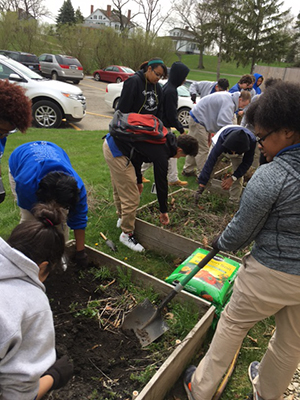 Students planting a garden for Food and Agriculture Class